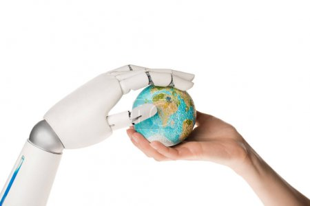 cropped shot of robot and human holding miniature model of earth isolated on white