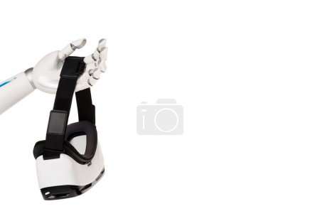 cropped shot of robot holding vr headset isolated on white