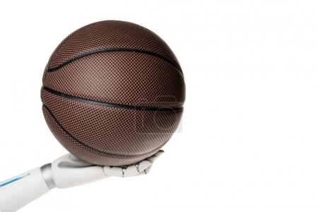 cropped shot of robot holding basketball ball isolated on white