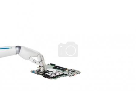 Photo for Cropped shot of robot touching computer circuit board isolated on white - Royalty Free Image