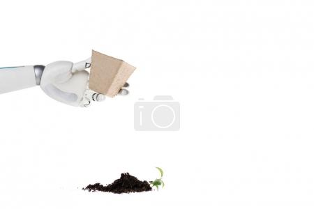 cropped shot of robot holding pot and heap of ground with plant spilled on floor isolated on white
