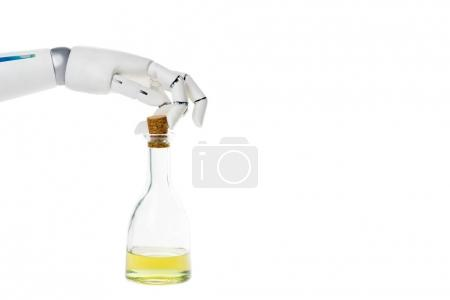 cropped shot of robot with bottle of olive oil isolated on white