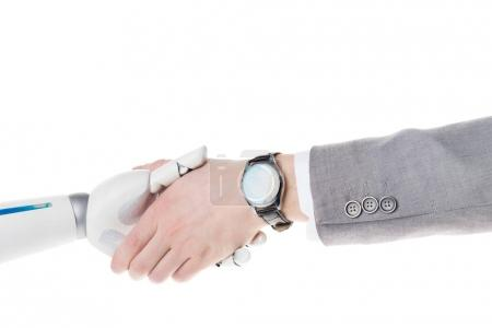 cropped shot of robot and businessman shaking hands isolated on white