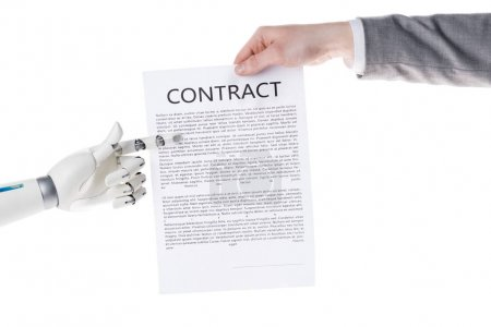 cropped shot of robot pointing at business contract in hand of businessman isolated on white