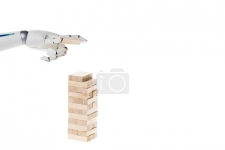 cropped shot of robot playing blocks tower game isolated on white