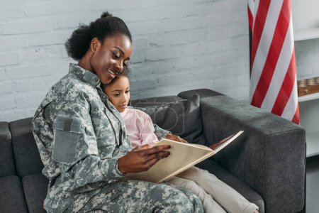 Mother soldier and african american child reading book