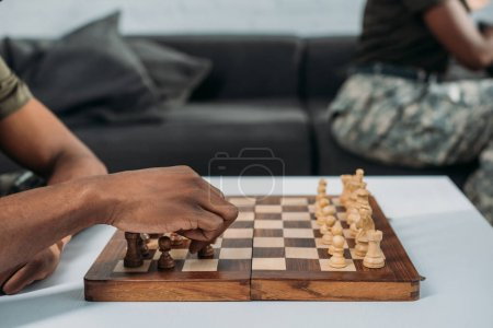 Close-up view of man playing chess game