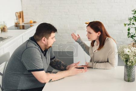 Overweight couple arguing
