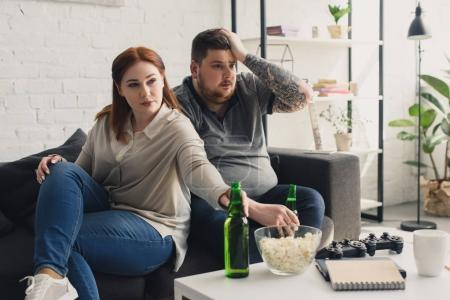 size plus boyfriend and girlfriend watching tv at home