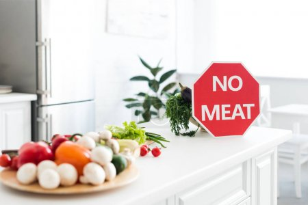 ripe tasty vegetables and no meat sign on kitchen counter