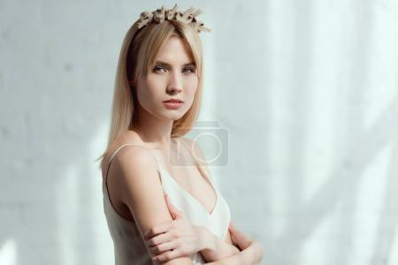 thoughtful woman in dress with wreath made of fresh mushrooms on head, vegan lifestyle concept