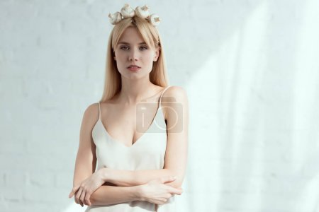 portrait of pretty woman in dress with wreath made of fresh mushrooms on head, vegan lifestyle concept