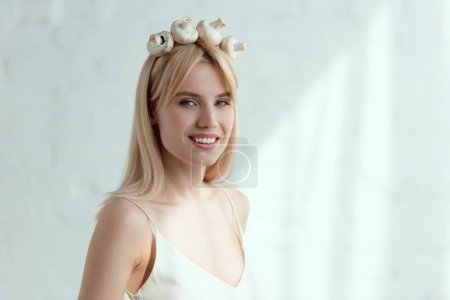 pretty smiling woman in dress with wreath made of fresh mushrooms on head, vegan lifestyle concept