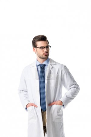 Confident male doctor wearing white coat isolated on white