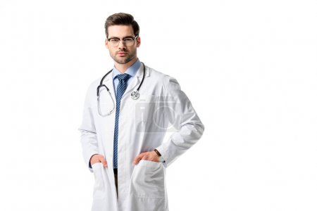 Confident male doctor wearing white coat with stethoscope isolated on white