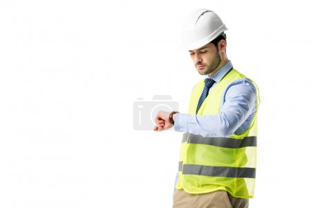 Construction worker in reflective vest checking his watch isolated on white