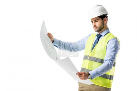Thoughtful builder in reflective vest looking at blueprint isolated on white
