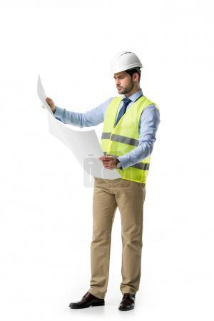 Architect in reflective vest and hardhat looking at blueprint isolated on white