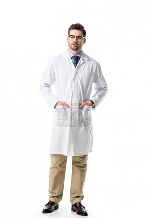 Photo for Handsome doctor in glasses wearing white coat isolated on white - Royalty Free Image