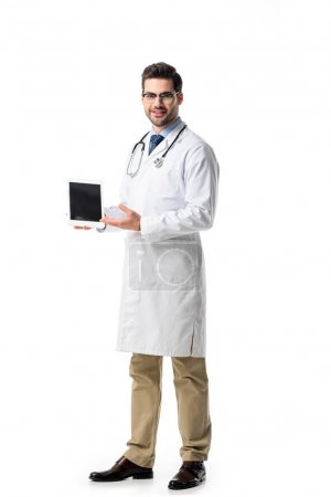 Doctor in glasses wearing white coat with stethoscope presenting digital tablet isolated on white