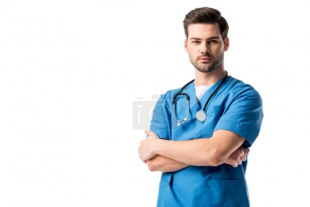 Surgeon  wearing blue uniform with stethoscope standing with folded arms isolated on white