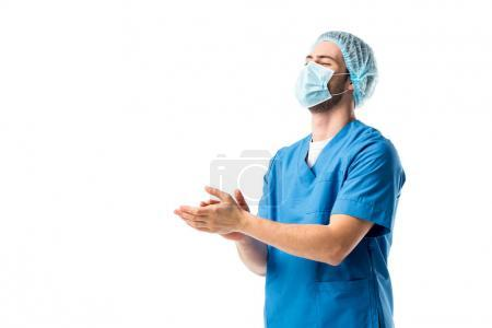 Male nurse wearing blue uniform and applauding isolated on white