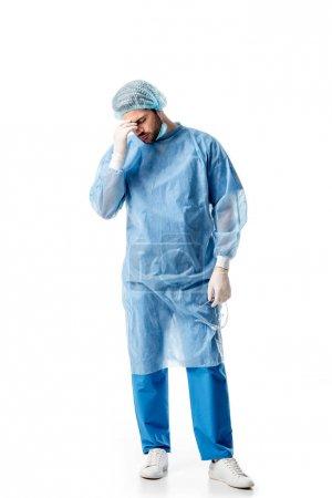Foto de Malestar cirujano vestida con uniforme azul aislado en blanco - Imagen libre de derechos