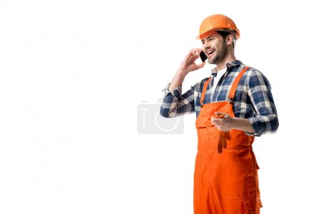 Handyman in orange overall and helmet talking on the phone isolated on white