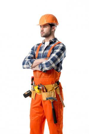 Confident repairman in orange overall and tool belt isolated on white