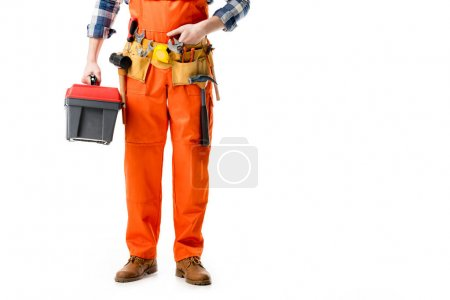 Cropped view of repairman holding tool box in orange overall isolated on white