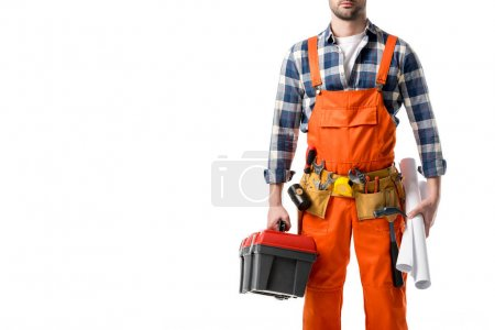 Cropped view of man in orange overall holding tool box and blueprint isolated on white