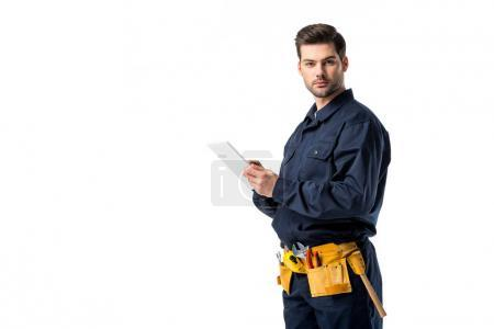 male plumber in uniform with digital tablet looking at camera isolated on white