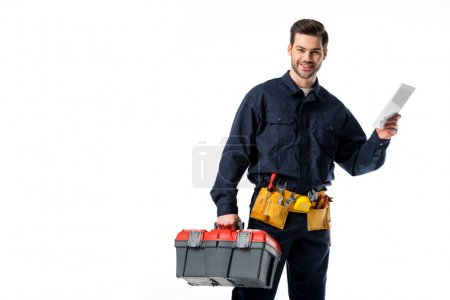 Photo for Portrait of smiling plumber in uniform with tool box and digital tablet isolated on white - Royalty Free Image