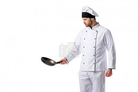 portrait of young chef in uniform with frying pan isolated on white