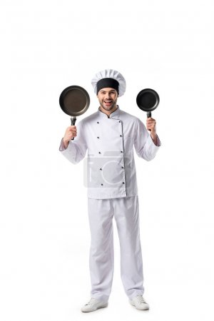 young emotional chef in uniform with frying pans  isolated on white