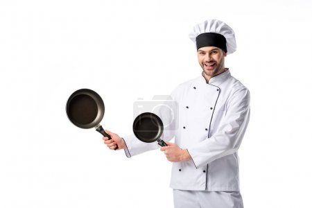 Photo for Young emotional chef in uniform with frying pans  isolated on white - Royalty Free Image