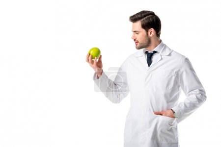 portrait of nutritionist in white coat with fresh apple in hand isolated on white