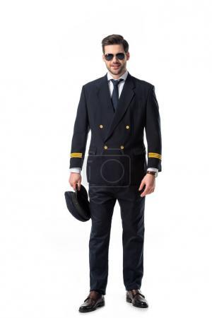 young bearded pilot in uniform and sunglasses isolated on white