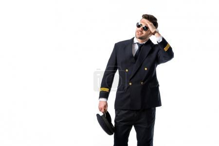 portrait of young pilot in sunglasses looking away isolated on white