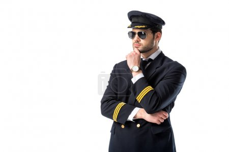 portrait of young pensive pilot in sunglasses isolated on white