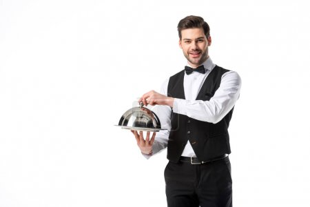 Photo for Portrait of handsome smiling waiter in suit vest with serving tray isolated on white - Royalty Free Image