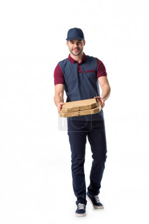 smiling delivery man with cardboard pizza boxes isolated on white