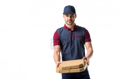 portrait of young delivery man with cardboard pizza boxes isolated on white
