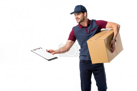 Photo for Smiling delivery man with cardboard box, empty notepad and pen isolated on white - Royalty Free Image