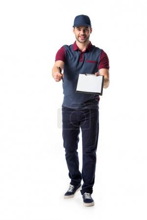 smiling delivery man with empty notepad and pen isolated on white