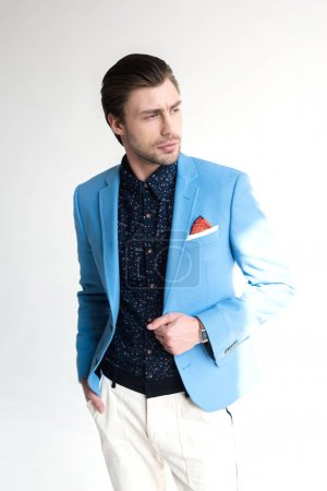 handsome young man in stylish blue jacket on white
