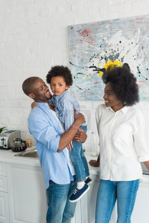 african american family standing in kitchen in morning at home