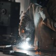 Cropped shot of worker in protection mask welding ...