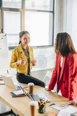 Professional business colleagues women in modern office