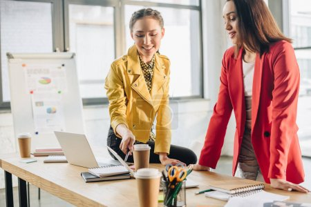 Successful businesswomen working together in modern light office